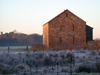 warm sandstone barn on a cold winter day